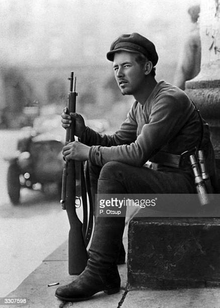 A young Bolshevik volunteer with grenades in his bandolier holding a boltaction rifle during the civil war in Russia
