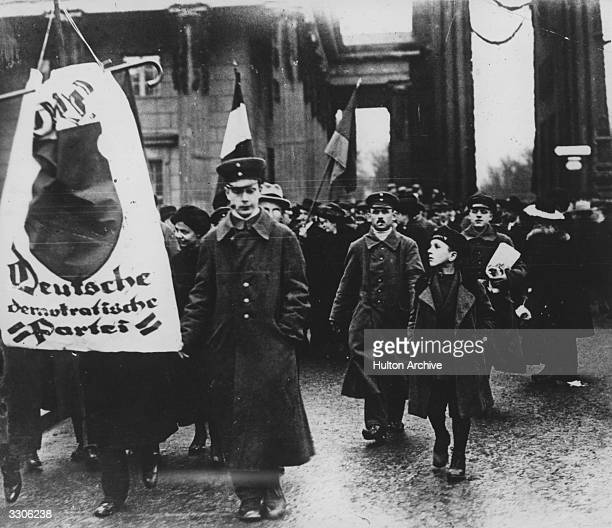Demonstrators in the streets of Berlin during the Spartacist uprising which broke out in Berlin following Germany's defeat in World War I