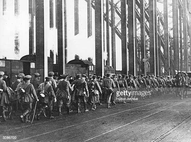 German troops return across the Rhine from Cologne prior to the French occupation of the Rhineland