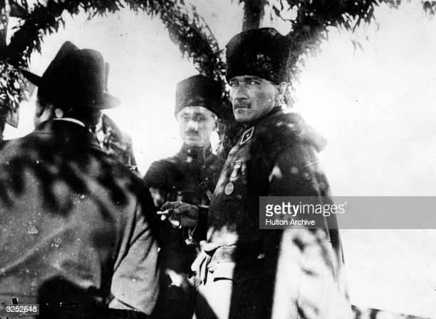 Kemal Ataturk president of Turkey talks with his advisors