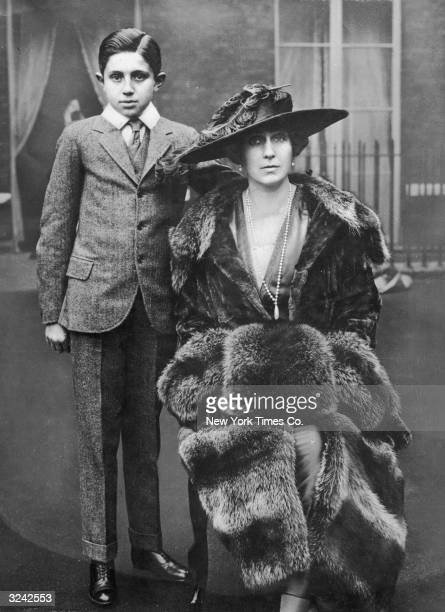 Portrait of Victoria Eugenie of Battenberg Queen of Spain and wife of Alfonso XIII with her son Don Jaime on the roof of Kensington Palace in London...