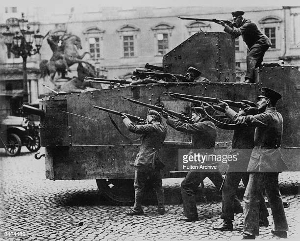 Soldiers firing on loyalist officers in Berlin Castle from an armoured vehicle during the Spartacist uprising in Berlin