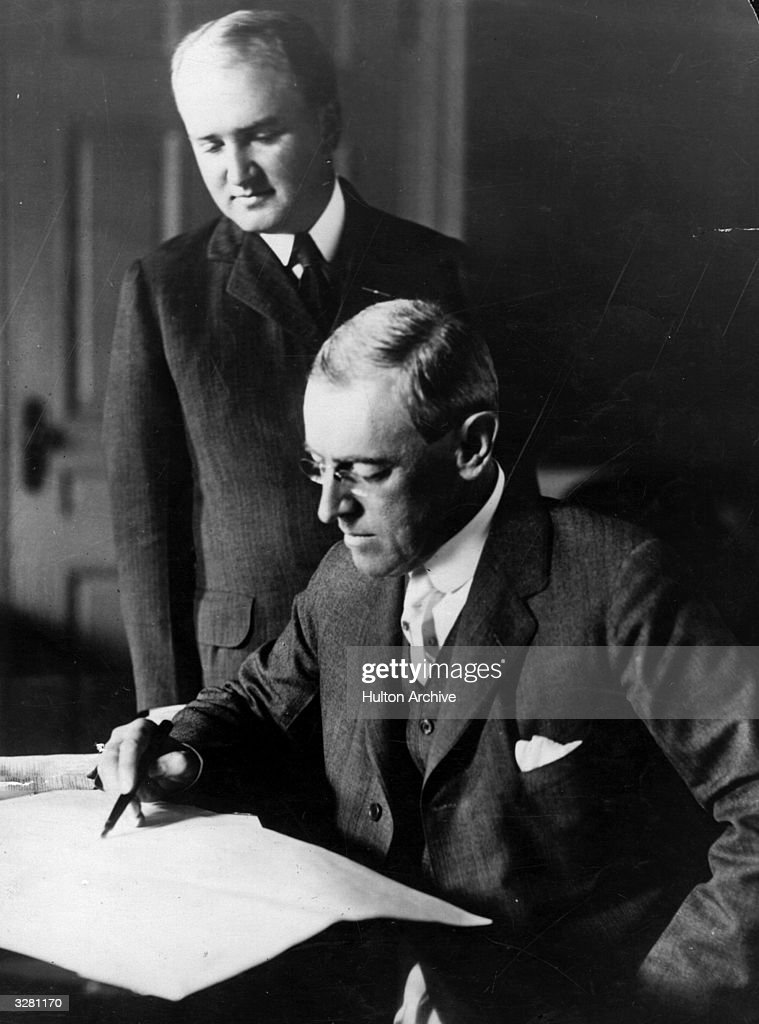 Woodrow Wilson (1856 - 1924), 28th President of the United States of America (1913 - 1921) with his secretary 'Joo' Tumulty. A Democrat, he kept America out of the 1st World War until 1917. He received the Nobel Peace Prize in 1919. Born in Virginia he became Governor of New Jersey in 1910. In 1919 he had a stroke, from which he never fully recovered.