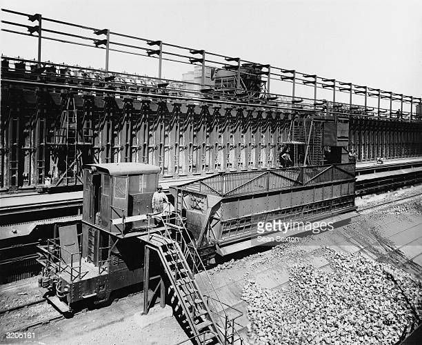 Ton coke quenching car with electric locomotive at the Fell coke works in Consett, County Durham.