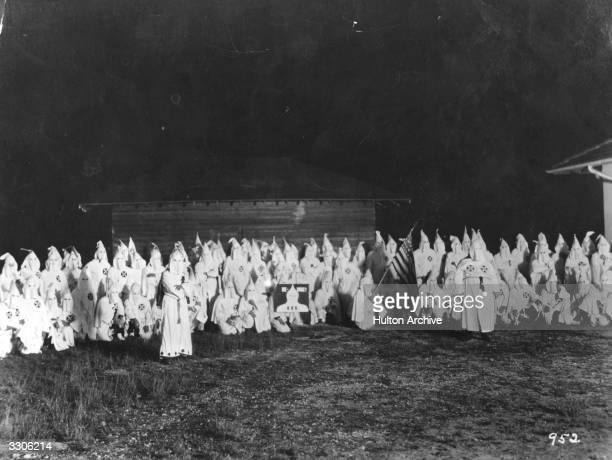 A meeting of the hooded members of the American white supremecist movement the Ku Klux Klan