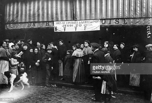 Queue for meat at a Paris butcher's shop, shortly after the City came under municipal control.