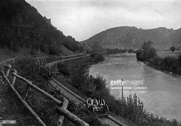 A railway line on the banks of the Muresul River in Transylvania