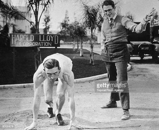 American comedian and actor Harold Lloyd fires a starting pistol for his cousin Keith Lloyd an accomplished sprinter outside the Harold Lloyd...