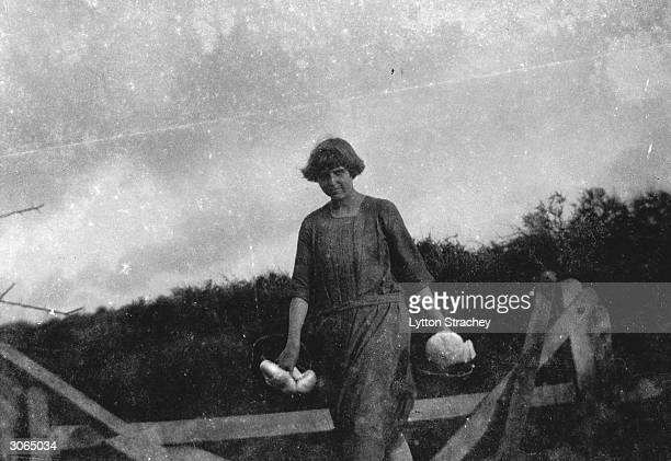 An early photograph of British artist Dora Carrington out collecting 'puffball' mushrooms