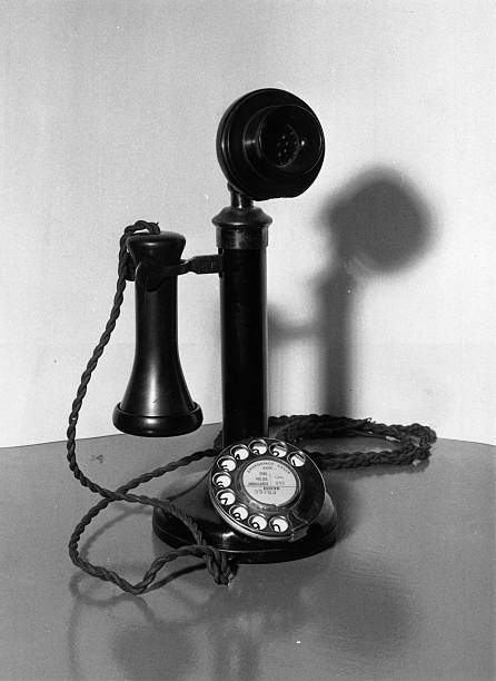 An old-fashioned candlestick telephone.