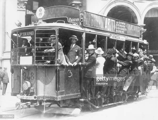 Fascists in Milan break the socialist strike by driving the trams themselves thus providing free transport for all