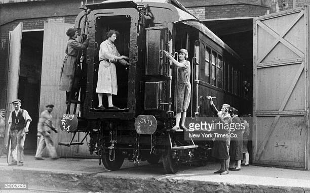 Female workers repaint the railroad car in which the armistice between the Allied and German Forces was signed ending World War I The Armistice was...