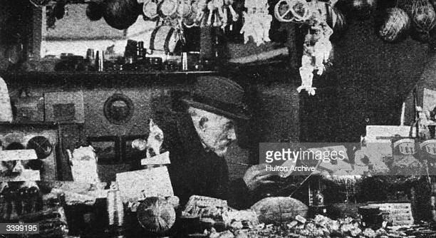 French magician actor film maker designer and theatre manager Georges Melies selling toys