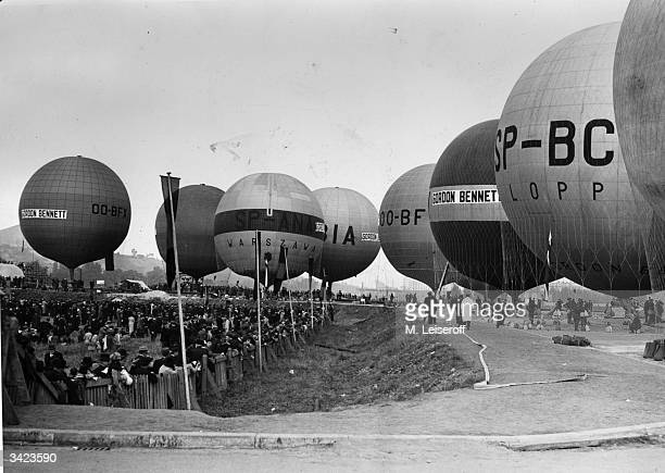Hot air balloons about to take off The name Gordon Bennett a wealthy American journalist who was a sponsor of ballooning is clearly displayed on two...
