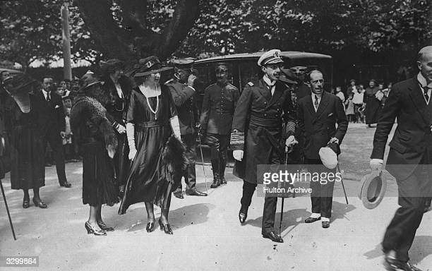 King Alfonso XIII of Spain king from 1886 to 1931 walks with his wife Queen Victoria Eugenie of Spain in the public gardens in Bilbao