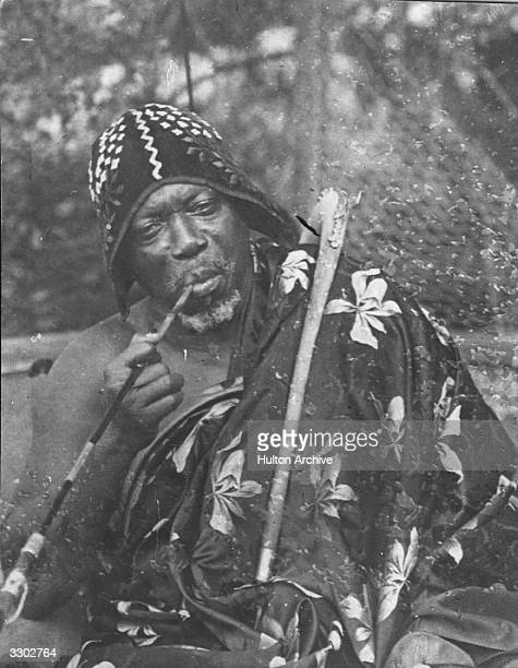 King Behanzin of Dahomey smoking a pipe