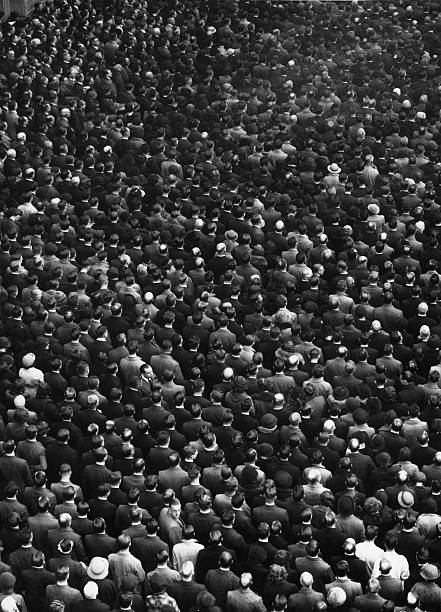 London crowds bow their heads in observance of a twominute silence on Armistice Day
