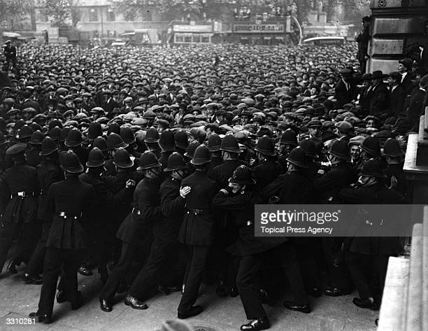Police pushing back the crowd at an unemployment demonstration in Whitehall London