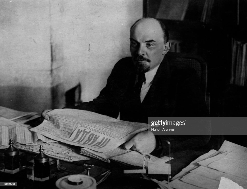 Russian revolutionary and communist leader Vladimir Ilyich Lenin (1870 - 1924) reading a copy of Russian newspaper 'Pravda'.