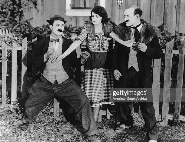 Sybil Seely stands between Charles Doherty and Scottishborn actor James Finlayson in order to prevent a fight in a still from an unidentified silent...