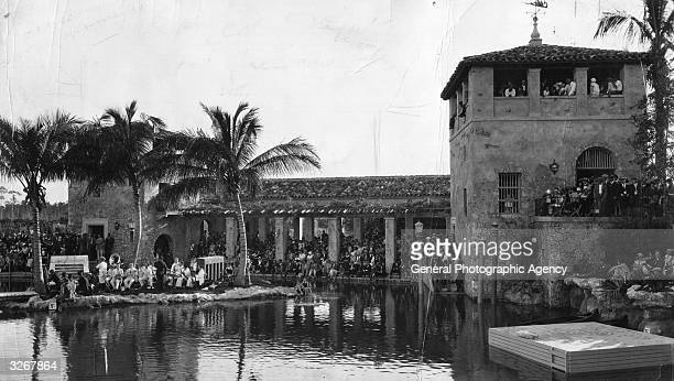 The famous Venetian bathing pool at Coral Gables Miami Florida attracts a huge crowd for the season