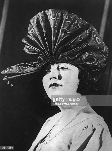A woman wearing an unusual hat
