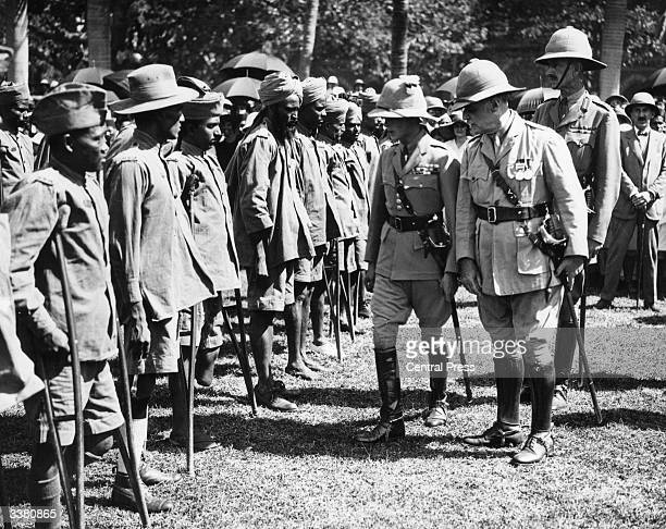 Edward the Prince of Wales later King Edward VIII of Great Britain inspecting maimed soldiers during a visit to Bombay India