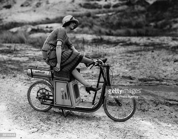 Gladys Ross on a scooter at Le Touquet, France.