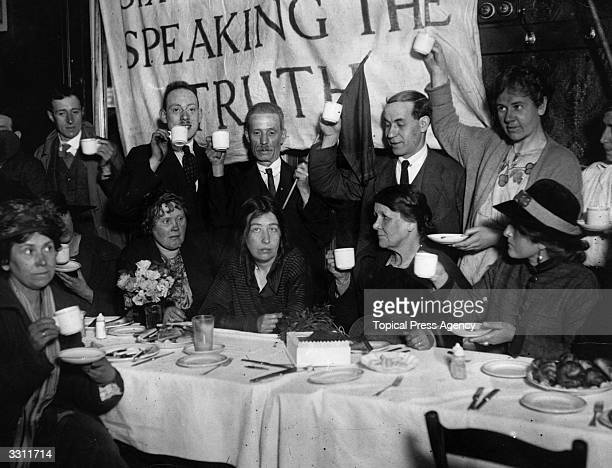 Recently released from prison militant suffragette leader Sylvia Pankhurst is toasted at a celebration breakfast in East London