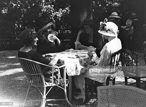 A bridge game at a Paris garden party