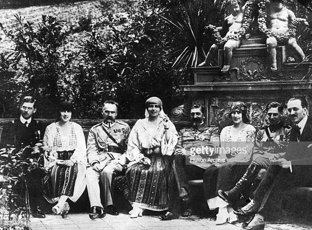 Marie, Queen of Romania relaxing with her son Crown Prince Carol , Marshal Pilsudski , Princess Irene von Grischenland and Prince Nicholas.