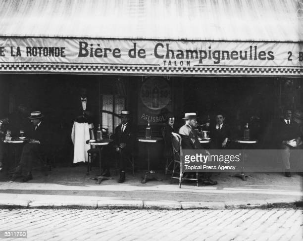 Patrons outside a street cafe in Paris