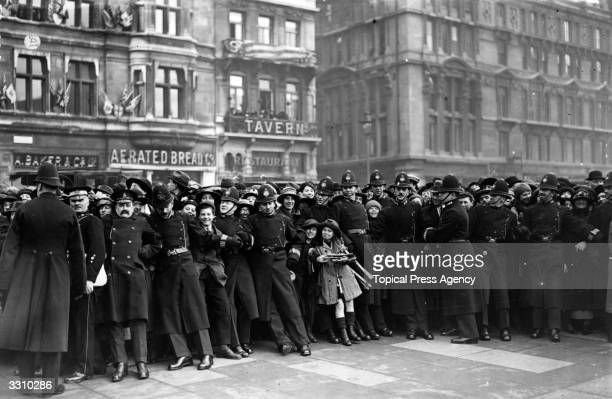 Police keeping back the crowds during the wedding of the Earl of Harewood to Princess Mary the Princess Royal at Westminster Abbey