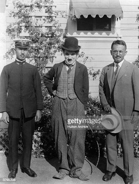 Sir Charles Spencer Chaplin the English film actor and director with the Vice Consul of Japan and a Japanese Naval Officer Chaplin was born in...