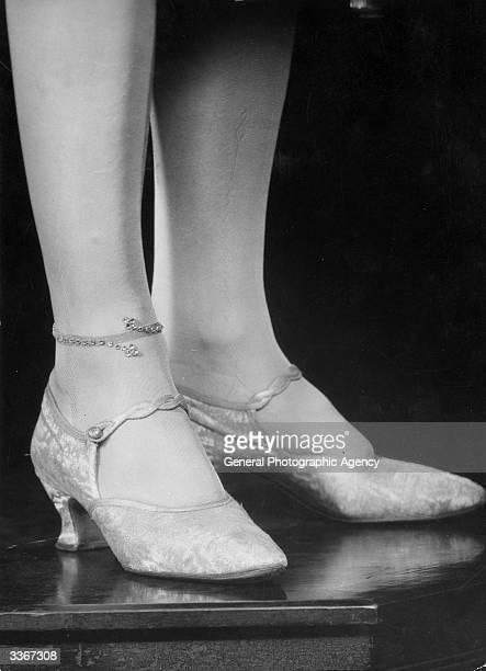 A closeup of Dorothea Varda London's bestknown mannequin appearing at 'Still Dancing At The Pavilion' wearing the latest vogue beaded stockings
