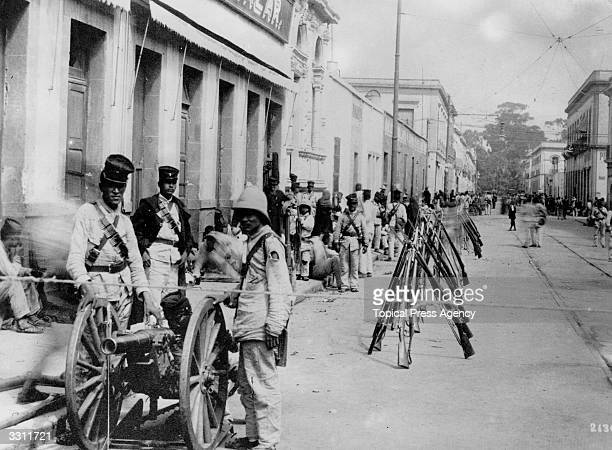 A group of troops gather in the street during the Mexican Revolution