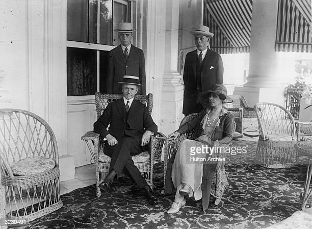 A portrait of Calvin Coolidge his wife Grace and his sons John and Calvin Jr posing on their porch in Massachusetts Coolidge became vicepresident of...