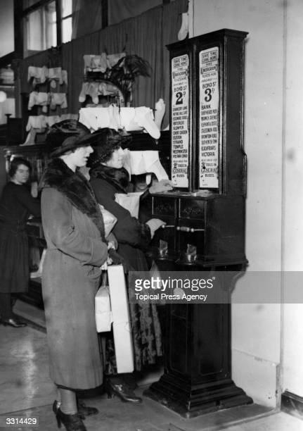 Tube ticket dispensing machine in the department store Selfridges, London.