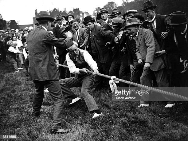 Labour leader Ramsay MacDonald in a tug of war match at a Labour Party gathering
