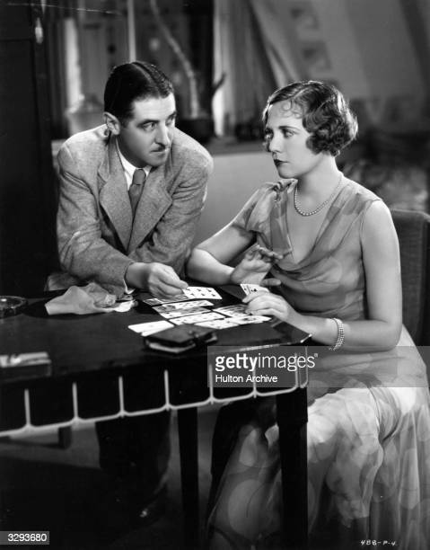 Lois Wilson reads the tarot cards for Mel Brown the director in between shots of the RKO production of 'I Love You'