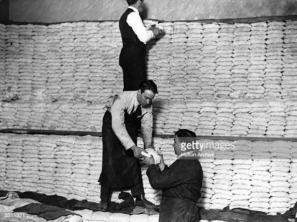 Men stacking silver at the Royal Mint