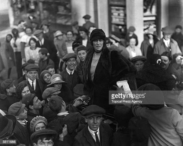 Nancy Astor arguing with a spectator at the hustings during the election campaign in Plymouth.