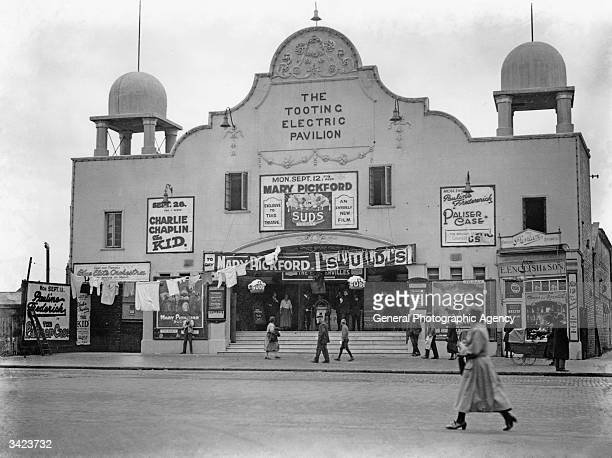 Posters advertise films starring Mary Pickford and Charlie Chaplin on show at the Tooting Electric Pavilion