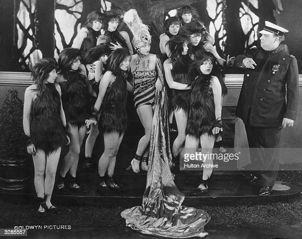 Group of women wearing skimpy fur outfits in a scene from the film 'D-Zug Des Grauens'.