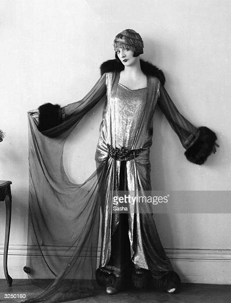 English actress Elsie Randolph dressed in stunning eveningwear designed by Norman Hartnell.
