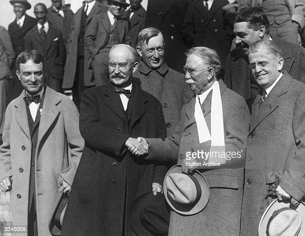 Former US Secretary of the Interior Albert Fall shakes hands with American oil magnate Edward Doheny flanked by their lawyers after their acquittal...