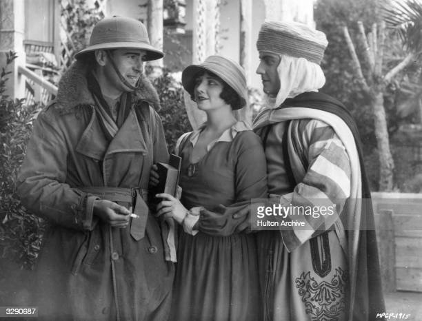 Irish actor Rex Ingram on set with his wife Alice Terry and Ramon Novarro during the filming of 'The Arab' for MGM