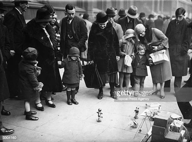 Mechanical toys being demonstrated and sold on the pavement at Holborn Christmas Toy Market