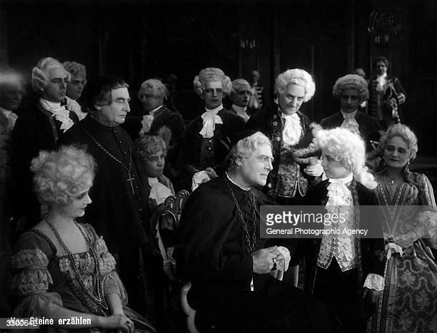 A court scene where the young Mozart meets influential people in the film 'Was Steine Erzahlen'