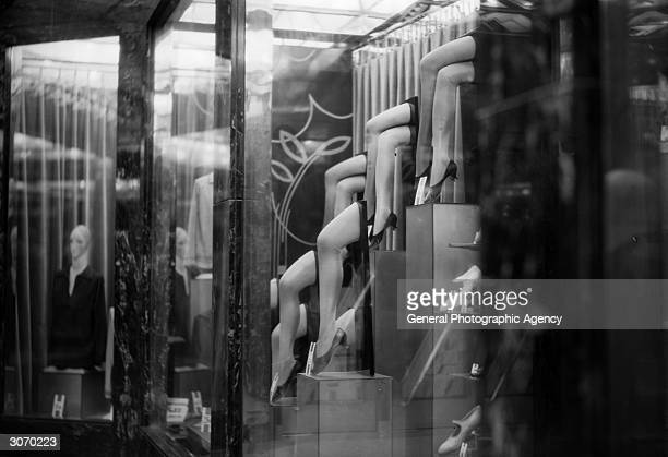 A display of sheer nylons in a shop window possibly Harrods of London during their Great Summer Sale
